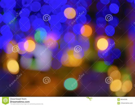 abstract blur city or club blue green yellow purple light background stock