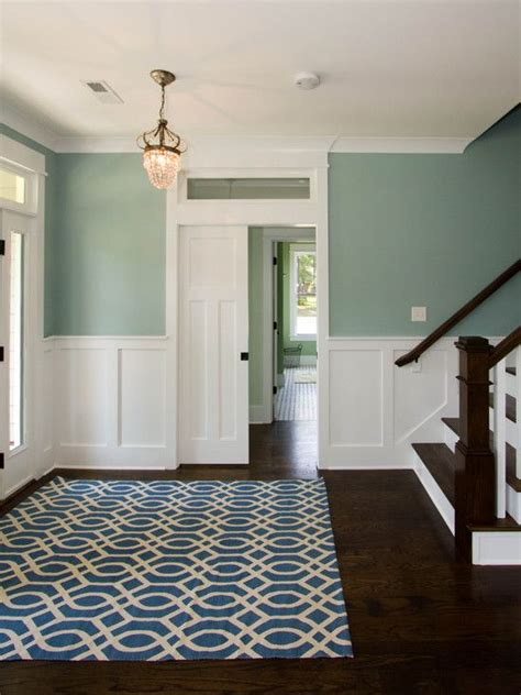 dark plank flooring white panelingchair rail white
