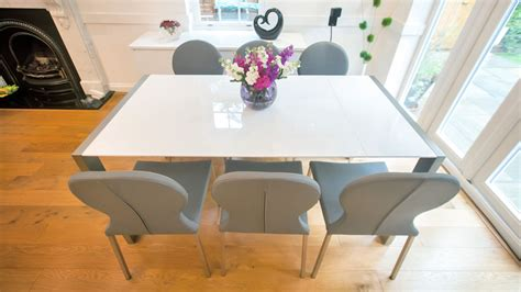 modern white gloss extending dining table  retro chairs