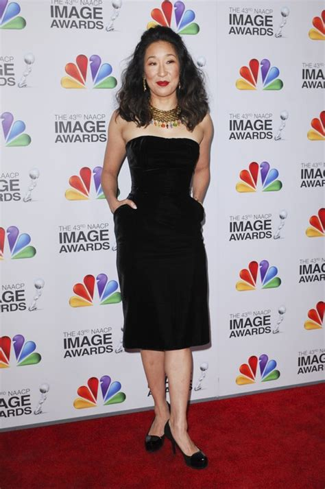 sandra oh red dress designer 2012 naacp image awards red carpet fashions