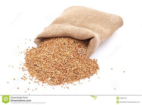 burlap sack with buckwheat spilling stock photo image