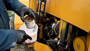 John Deere Fuel Filter Replacement On The 310a Backhoe