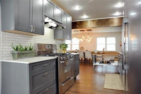 transitional kitchen  gray cabinets rustic wood beam