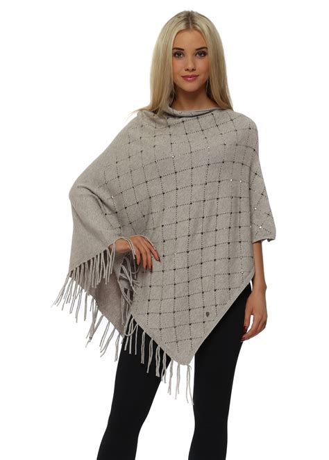 beige poncho with silver studs oversized beige knitted poncho