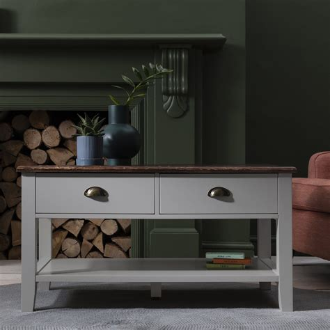 They can have open storage or actual. Grey Wooden Coffee Table with 4 Storage Drawers - Laura James