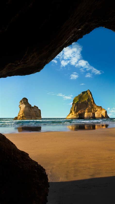 wharariki beach cave archway islands south island