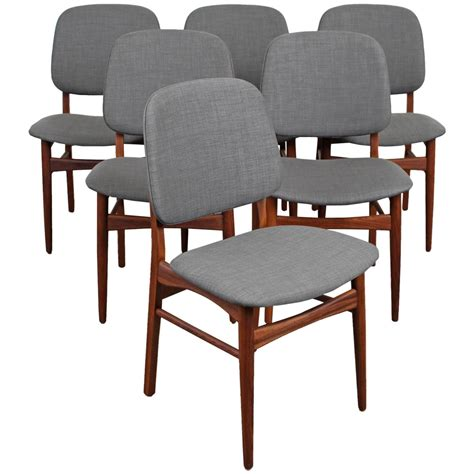 set of six mid century modern teak dining chairs at