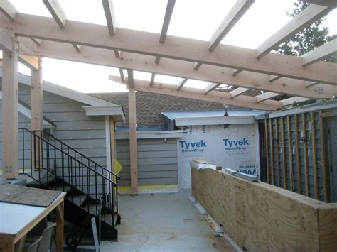 100 timber framed carriage shed raising rooftop