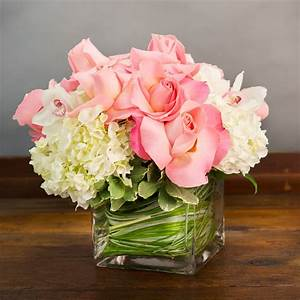 WHITE HYDRANGEA AND PINK ROSES WITH CYMBIDIUM ORCHIDS IN A ...