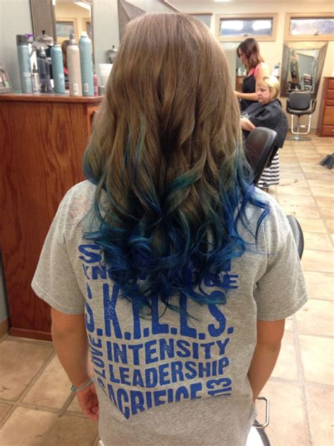 Long Brown Curled Hair With Blue Dyed Tips Dyed Hair In
