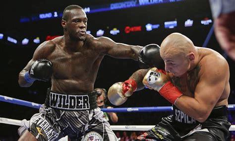 deontay wilder retains heavyweight title  devastating