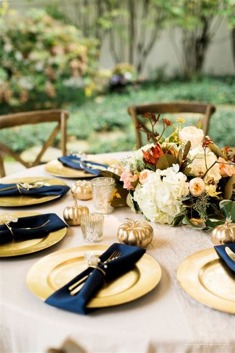 picture   fall tablescape  gold chargers navy