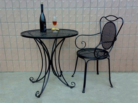 wrought iron tables and chairs and coffee tables and