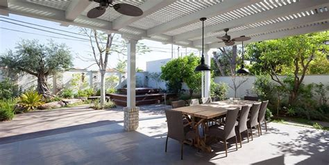 extended pergola offers shade to the patio with green
