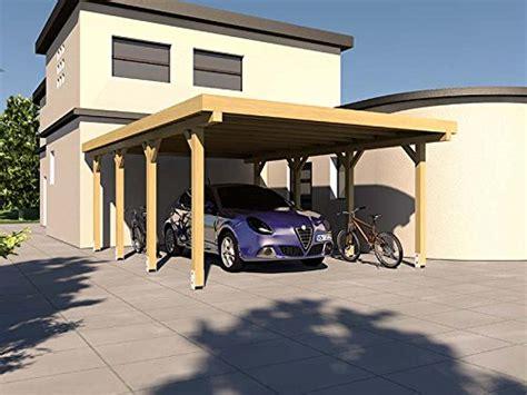 carport aus rundstämmen flachdach garage aufbau flachdach f r die doppelgarage unser holz doppelgarage mit schwingtor