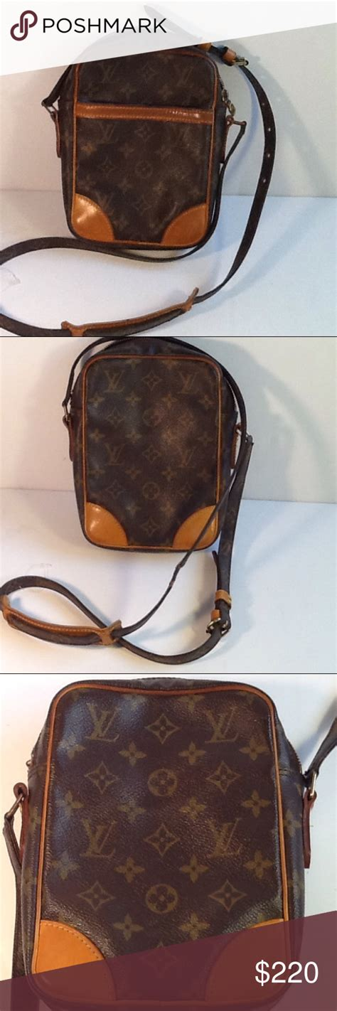 authentic louis vuitton danube monogram crossbody   leather pieces   side  hold