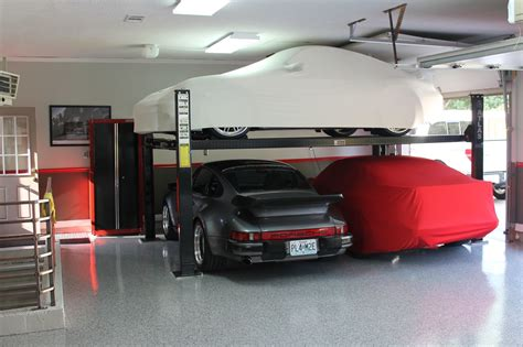 garage lifts for cars guys with 4 post car lifts in their garages i