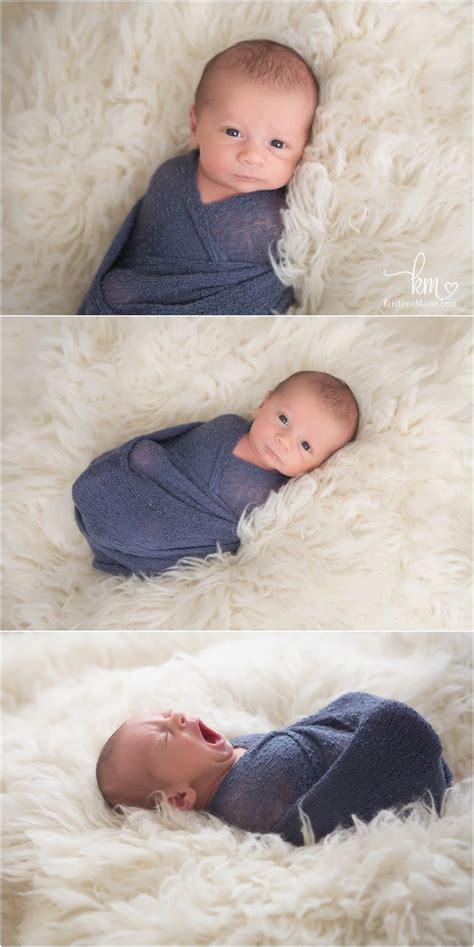 awake newborn photography posese newborn boy swaddled