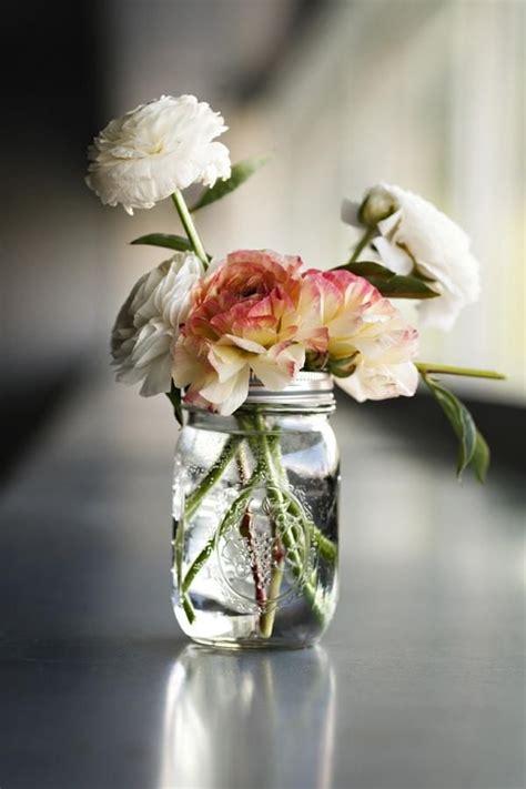 flowers in jars a simple mason jar full of flowers floral pinterest