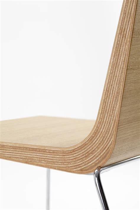 sled base wooden chair boomerang by ondarreta design
