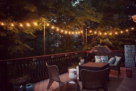 string lights over patio diy hanging outdoor string lights debbiedoos