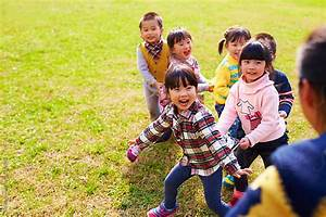 happy asian kids playing outdoor in the park by Bo Bo ...
