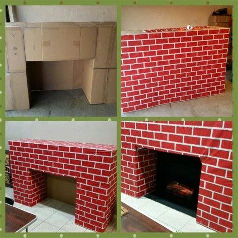 santas entrance fireplace   cardboard boxes