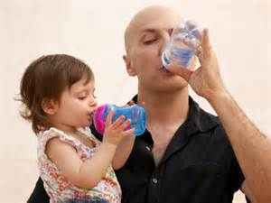 Father with Kids Drinking Water