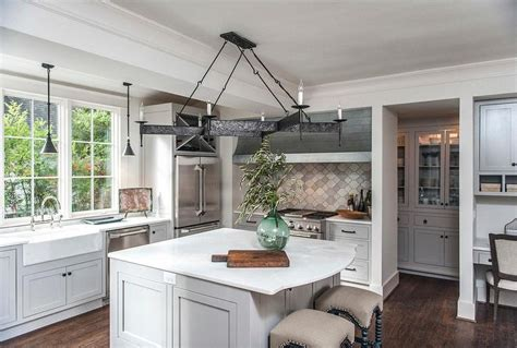 Gray Kitchen Island with Curved Marble Countertop