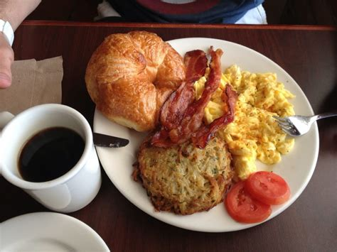 Country French Breakfast (2 eggs scrambled, potato galette and bacon with fresh baked croissant