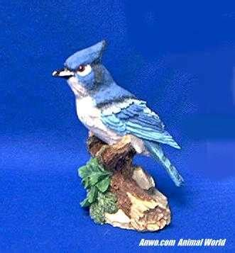 blue jay figurine bird statue  spring branch  animal