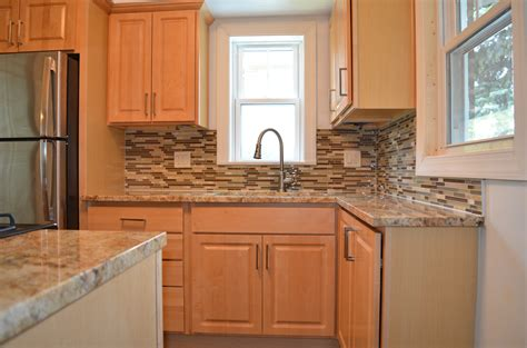 pictures of kitchen cabinets and countertops kitchen remodel with natural maple cabinets granite