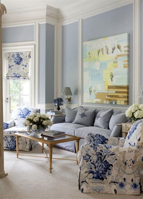 Living Room With Blue Decor by The Fabric On The Chair And Shade And The Artwork