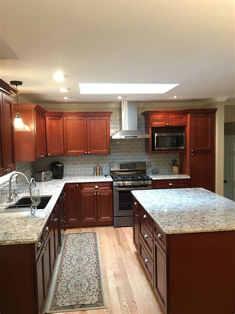 used kitchen cabinets bc cherry kitchen cabinets with gray wall and quartz 8789