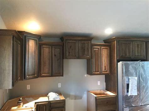 Dark stain hickory cabinets with crown moulding   Kitchen