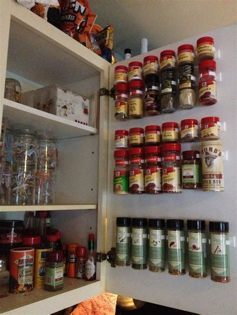 I organized my spice cabinet using spice clips from