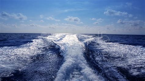 Fast Wake Boats by Blue Ocean Sea With Fast Yacht Boat Wake Foam Footage