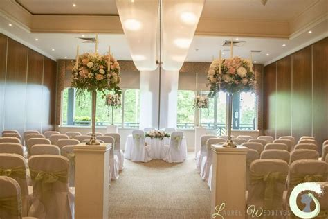 decorate wedding ceremony room wedding ceremony flowers on plinths ceremony room decorations at the mere pink and