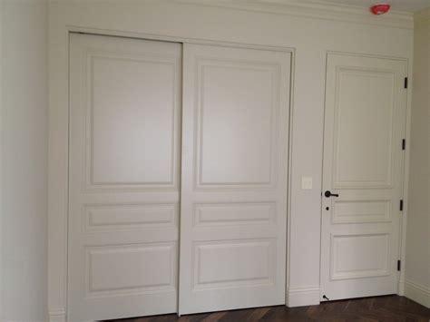 bypass closet doors closet modern with arched door beveled