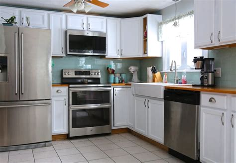 Painted Oak Cabinets by How To Paint Oak Kitchen Cabinets Weekend Craft