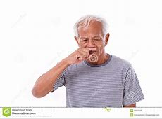 Elderly Man With A Runny Nose Looking For Cure On The
