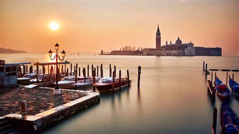 venice italy piazza san marco sunset orange sky sea water