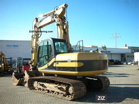 jcb js  lc tab  caterpillar digger construction equipment photo  specs