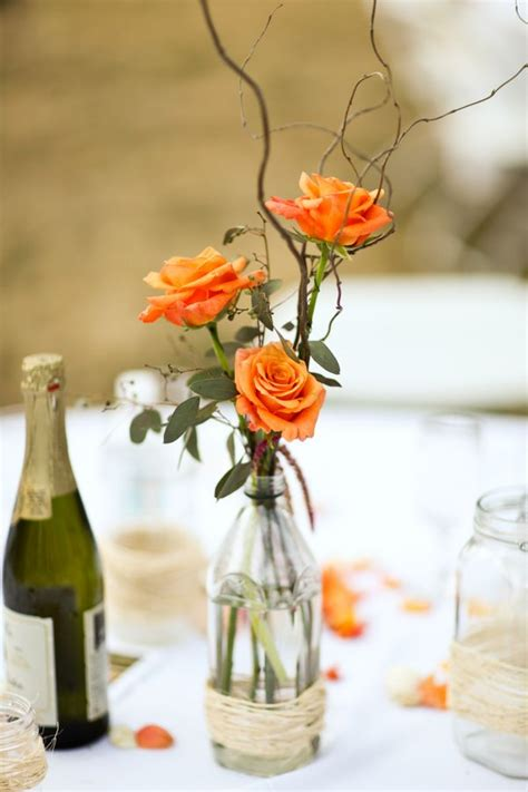 fall wedding centerpieces centerpiece vibrant flowers roses branches orange fun leaves