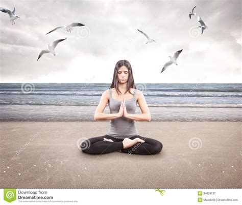 young girl  yoga   beach stock image image