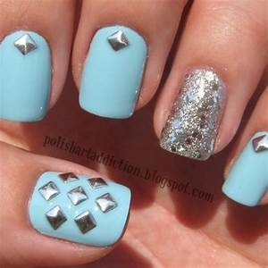 Studded nails and silver sparkly nail on ring finger ...