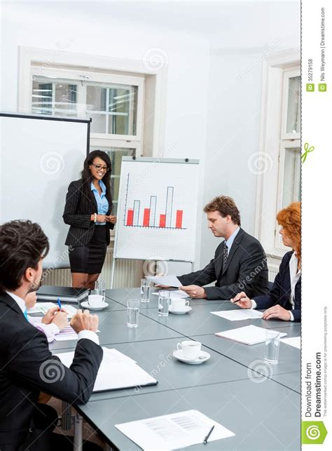15166 business meeting presentation business team in office meeting presentation royalty free