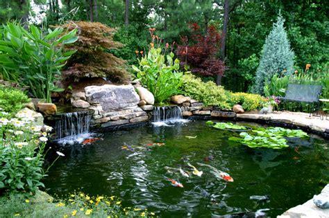 landscape with pond higher s koi pond traditional landscape atlanta by artistic landscapes