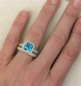 blue topaz engagement ring cushion cut blue topaz and halo engagement ring and wedding band with milgrain edging