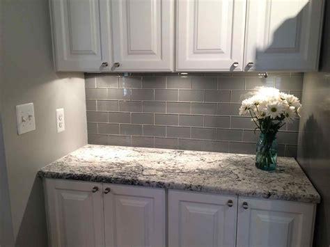 gorgeous backsplash white cabinets gray countertop
